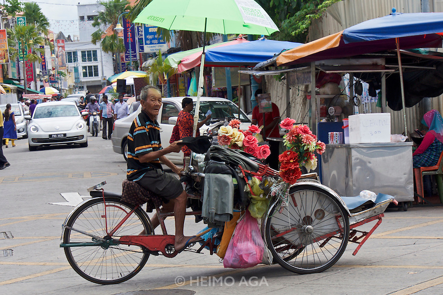 Malaysia, Penang. Old Georgetown Streets - a UNESCO World Heritage site. Rickshaw.