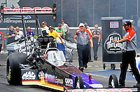 Jun. 16, 2012; Bristol, TN, USA: NHRA crew chief Richard Hogan (center) reacts to a problem to the top fuel dragster of Steve Torrence during qualifying for the Thunder Valley Nationals at Bristol Dragway. Mandatory Credit: Mark J. Rebilas-