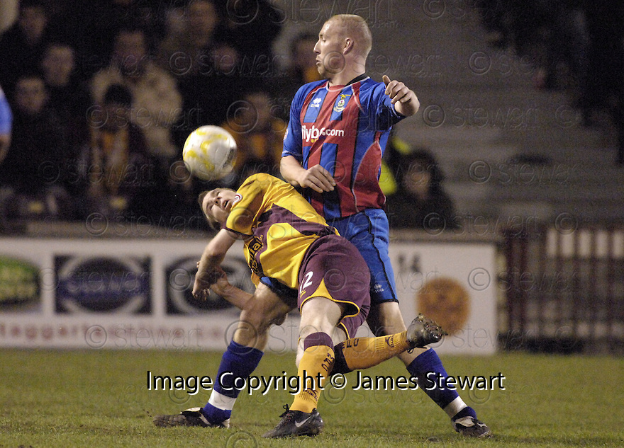 20/02/2008    Copyright Pic: James Stewart.File Name : sct_jspa06_motherwell_v_ICT.DAVID CLARKSON IS BUNDLED OFF THE BALL BY ROSS TOKELY.James Stewart Photo Agency 19 Carronlea Drive, Falkirk. FK2 8DN      Vat Reg No. 607 6932 25.Studio      : +44 (0)1324 611191 .Mobile      : +44 (0)7721 416997.E-mail  :  jim@jspa.co.uk.If you require further information then contact Jim Stewart on any of the numbers above........