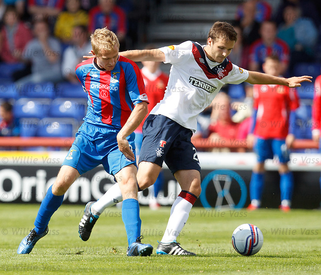 Jamie Ness gets another 90 minutes of first team football under his belt as he beats Richie Foran to the ball