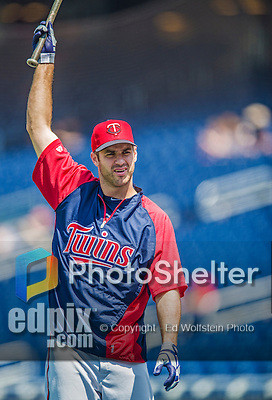 8 June 2013: Minnesota Twins catcher Joe Mauer warms up prior to a game against the Washington Nationals at Nationals Park in Washington, DC. The Twins edged out the Nationals 4-3 in 11 innings. Mandatory Credit: Ed Wolfstein Photo *** RAW (NEF) Image File Available ***