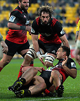 Israel Dagg is tackled as Sam Whitelock arrives in support during the Super Rugby match between the Hurricanes and Crusaders at Westpac Stadium in Wellington, New Zealand on Saturday, 15 July 2017. Photo: Dave Lintott / lintottphoto.co.nz