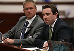 State tax director Chris Nielsen, left, and Gov. Brian Sandoval's general counsel Lucas Foletta, center, testify at a hearing at the Legislative Building in Carson City, Nev., on Tuesday, April 9, 2013..Photo by Cathleen Allison