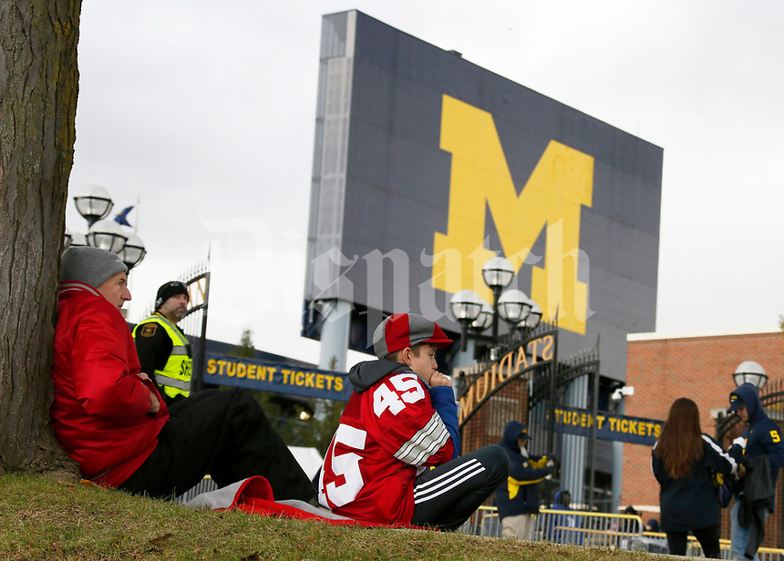Bill Donberg, left, and his grandson Ani Lugin, 12, both of Elk Rapids, Mich., wait for the gates to open at Michigan Stadium before Saturday's NCAA Division I football game between the Michigan Wolverines and the Ohio State Buckeyes at Michigan Stadium in Ann Arbor on November 25, 2017. Lugin says that he has been converted to a Buckeye fan by his family including Donberg. [Barbara J. Perenic/Dispatch]