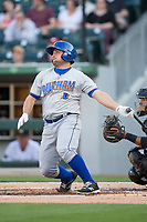 Michael McKenry (7) of the Durham Bulls follows through on his swing against the Charlotte Knights at BB&T BallPark on May 15, 2017 in Charlotte, North Carolina. The Knights defeated the Bulls 6-4.  (Brian Westerholt/Four Seam Images)