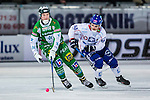 Stockholm 2013-11-26 Bandy Elitserien Hammarby IF - Edsbyns IF :  <br /> Hammarby Carl-Johan Rutqvist i kamp om bollen med Edsbyn Mattias Andersson<br /> (Foto: Kenta J&ouml;nsson) Nyckelord: