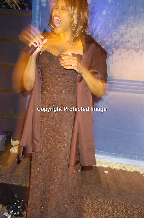 """Jennifer Holiday singing ..at Preston Bailey's Book Party for his new book """"Fantasy Weddings"""" on January 26, 2005 at The Rainbow Room. ..Photo by Robin Platzer, Twin Images"""