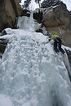 Ice climbing at Hidden Falls in Wild Basin, Rocky Mountain National Park, Colorado, USA; outdoor winter recreation and sport, model released, (MR#91)