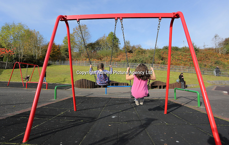 Pictured: Two girls on the swings at the Aberfan Memorial play ground, where the tragic school was. Friday 21 October 2016<br />