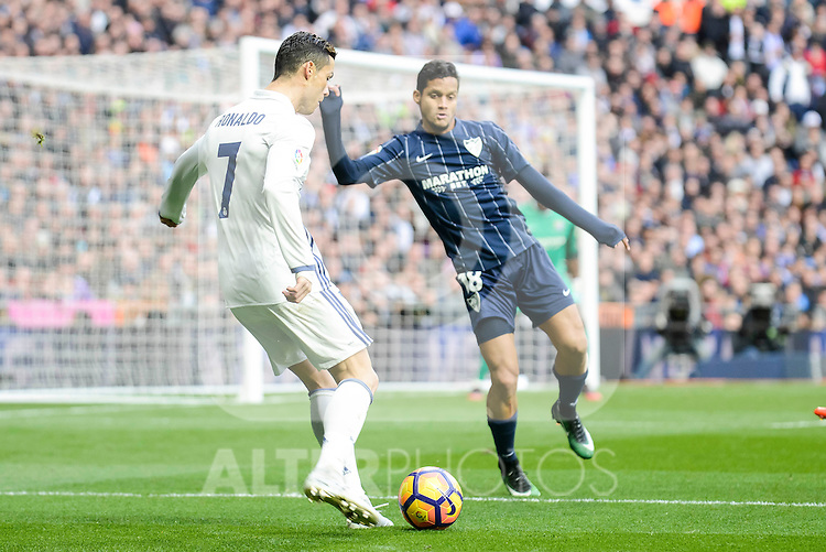Real Madrid's Cristiano Ronaldo and Malaga CF's Roberto Jose Rosales during La Liga match between Real Madrid and Malaga CF at Santiago Bernabeu Stadium in Madrid, Spain. January 21, 2017. (ALTERPHOTOS/BorjaB.Hojas)