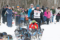 Gabe Dunham and team run past spectators on the bike/ski trail near University Lake with an Iditarider in the basket and a handler during the Anchorage, Alaska ceremonial start on Saturday, March 7 during the 2020 Iditarod race. Photo © 2020 by Ed Bennett/Bennett Images LLC