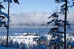 Idaho, Coeur d' Alene. The world famous Coeur d' Alene Resort Golf Course and floating green on Lake Coeur d' Alene covered by a blanket of snow, with rising mist in the distance.