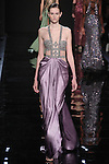 "Model walks runway in a lilac draped silk charmeuse dress with pewter embroidered bodice detail from the Reem Acra Fall 2016 ""The Secret World of The Femme Fatale"" collection, at NYFW: The Shows Fall 2016, during New York Fashion Week Fall 2016."