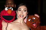 Rebecca Budig with Kevin Clash, Elmo and Sesame Street Pupprts.Attending the 37th Annual Daytime Emmy Awards.at Radio City Music Hall in New York City..May 21, 2004.