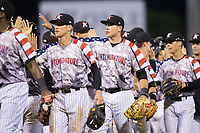 Brandon Dulin (31) of the Kannapolis Intimidators high fives his teammates following their win over the Hickory Crawdads in game two of a double-header at Kannapolis Intimidators Stadium on May 19, 2017 in Kannapolis, North Carolina.  The Intimidators defeated the Crawdads 9-1.  (Brian Westerholt/Four Seam Images)