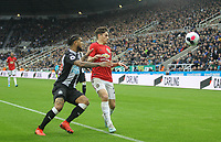 Daniel James of Man Utd & DeAndre Yedlin of Newcastle United during the Premier League match between Newcastle United and Manchester United at St. James's Park, Newcastle, England on 6 October 2019. Photo by J GILL / PRiME Media Images.