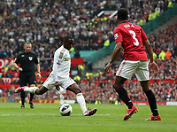 Pictured: Nathan Dyer of Swansea (L) takes a shot off target. Sunday 12 May 2013<br /> Re: Barclay's Premier League, Manchester City FC v Swansea City FC at the Old Trafford Stadium, Manchester.