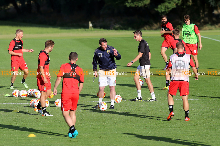 Stevenage Manager, Darren Sarll, talks tactics with his players during the Stevenage FC Press Day at Bragbury End Training Ground on 28th July 2016