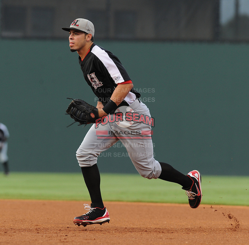 First baseman Kevin Torres (15) of the Hickory Crawdads in a game against the Greenville Drive on Sunday, September 2, 2012, at Fluor Field at the West End in Greenville, South Carolina. Hickory won, 8-4. (Tom Priddy/Four Seam Images)