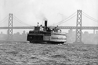 One of the last ferry boats in the Bay, San Francisco Bay Bridge and the city in background.