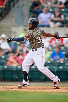 Arkansas Travelers right fielder Keury De La Cruz (34) follows through on a swing during a game against the Frisco RoughRiders on May 28, 2017 at Dickey-Stephens Park in Little Rock, Arkansas.  Arkansas defeated Frisco 17-3.  (Mike Janes/Four Seam Images)