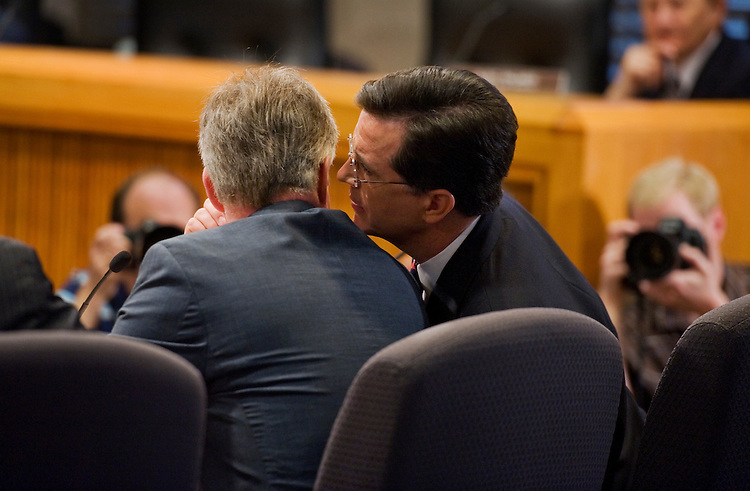 UNITED STATES - JUNE 30:  Stephen Colbert, right, of Comedy Central, has a word with his attorney Trevor Potter, during testimony at the Federal Election Commission (FEC) offices downtown where they appeared to request permission to set up a political action committee (PAC) called the Colbert Super PAC.  The request was subsequently approved by the commission. (Photo By Tom Williams/Roll Call)