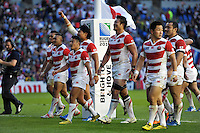Japan players celebrate their win with the crowd. Rugby World Cup Pool B match between South Africa and Japan on September 19, 2015 at the Brighton Community Stadium in Brighton, England. Photo by: Patrick Khachfe / Stewart Communications