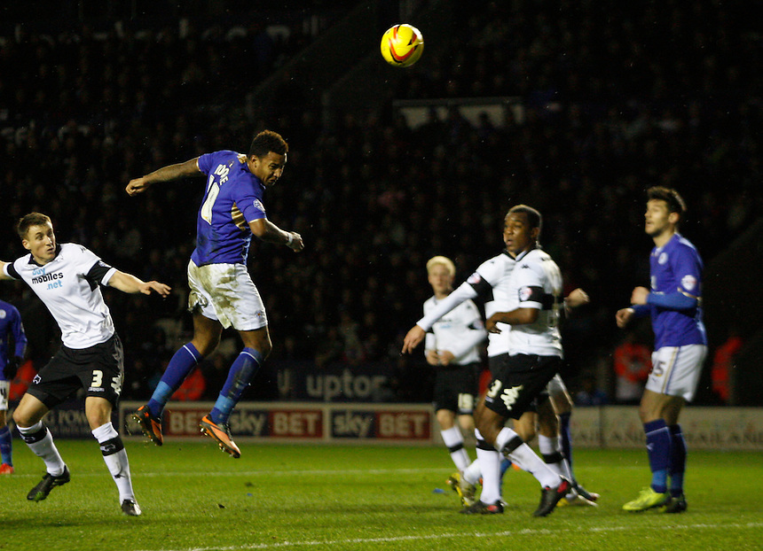 Leicester City's Liam Moore (C) heads at goal<br /> <br /> Photo by Jack Phillips/CameraSport<br /> <br /> Football - The Football League Sky Bet Championship - Leicester City v Derby County - Friday 10th January 2014 - King Power Stadium - Leicester<br /> <br /> &copy; CameraSport - 43 Linden Ave. Countesthorpe. Leicester. England. LE8 5PG - Tel: +44 (0) 116 277 4147 - admin@camerasport.com - www.camerasport.com