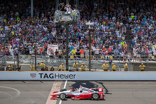 25.05.2015. Indianapolis, IN, USA.   Juan Pablo Montoya (2) takes the checkered flag to win the running of the 99th Indianapolis 500 in Indianapolis, IN.