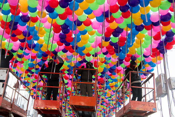 Workers attaching colourful balls over a street in Pyeongchang, South Korea, 07 February 2018. The Pyeongchang 2018 Winter Olympics take place between 09 and 25 February. Photo: Peter Kneffel/dpa /MediaPunch ***FOR USA ONLY***