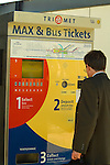Man Purchasing Tickets at the Sunset Transit Center
