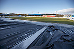 Central Park, Cowdenbeath with ice covered sheets and a sun drenched pitch after the game was called off