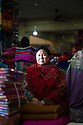 India - Manipur - Imphal - Radhesana Rajkumari, 70, a textile seller and President of one of the many women organisations running the market.