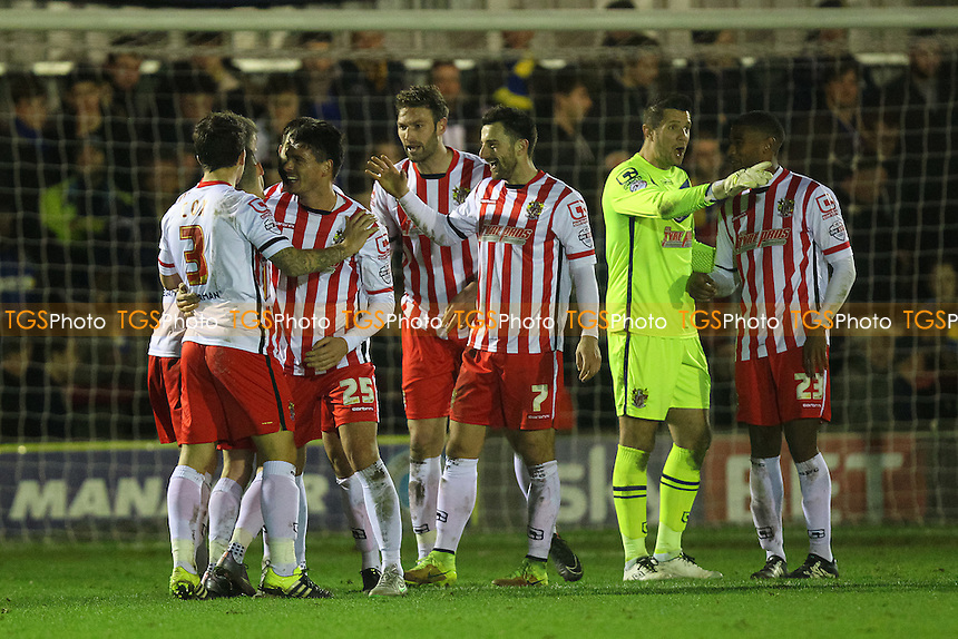 Stevenage players celebrate victory after the game during AFC Wimbledon vs Stevenage, Sky Bet League 2 Football at the Cherry Red Records Stadium, Kingston, England on 12/12/2015