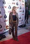 Actress Victoria Pratt arrives on the red carpet.
