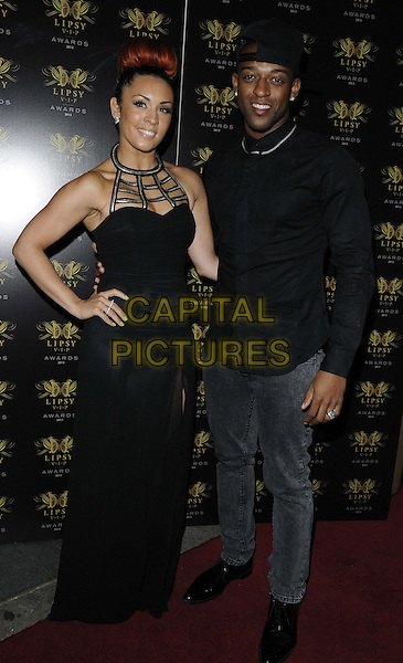 Amy Jane of VIDA &amp; Oritse Williams of JLS<br /> The Lipsy VIP Fashion Awards 2013, DSTRKT, Rupert St., London, England.<br /> May 29th, 2013<br /> full length black shirt backwards baseball cap hat dress jeans denim hand on hip<br /> CAP/CAN<br /> &copy;Can Nguyen/Capital Pictures