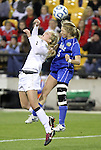 02 December 2011: Duke's Kaitlyn Kerr (5) and Wake Forest's Riley Ridgik (left). The Duke University Blue Devils defeated the Wake Forest University Demon Deacons 4-1 at KSU Soccer Stadium in Kennesaw, Georgia in an NCAA Division I Women's Soccer College Cup semifinal game.