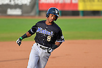 Fernery Ozuna (8) of the Missoula Osprey rounds the bases after hitting a home run against the Ogden Raptors on August 5, 2014 at Lindquist Field in Ogden, Utah. (Stephen Smith/Four Seam Images)