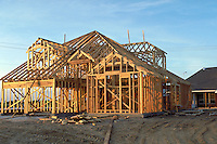 New home construction in suburban development. House frame. Houston Texas.