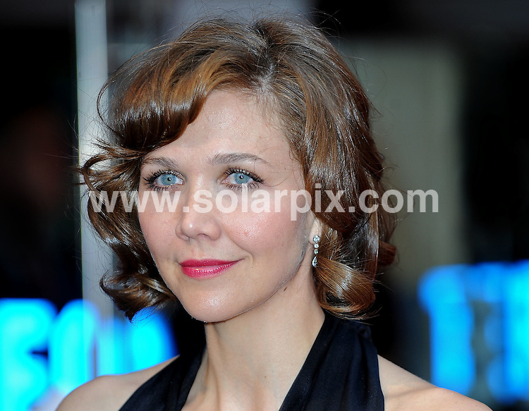 **ALL ROUND PICTURES FROM SOLARPIX.COM**.**WORLDWIDE SYNDICATION RIGHTS**.The Red carpet arrivals at the European Premiere of The Dark Knight Held at the Odeon in Leicester Square in London. ..This pic: Maggie Gyllenhaal...JOB REF: 6887-SSD DATE: 21_07_08.**MUST CREDIT SOLARPIX.COM OR DOUBLE FEE WILL BE CHARGED* *UNDER NO CIRCUMSTANCES IS THIS IMAGE TO BE REPRODUCED FOR ANY ONLINE EDITION WITHOUT PRIOR PERMISSION*