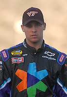 Apr 19, 2007; Avondale, AZ, USA; Nascar Nextel Cup Series driver Denny Hamlin (11) during qualifying for the Subway Fresh Fit 500 at Phoenix International Raceway. Hamlin is wearing a Virginia Tech hat in honor of those killed earlier this week. Mandatory Credit: Mark J. Rebilas