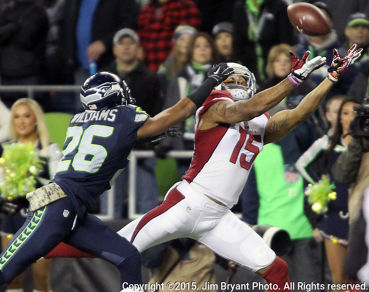 Arizona Cardinals wide receiver Michael Floyd (15) hauls in a 27 yard touchdown pass over defending Seattle Seahawks cornerback Cary Williams (26) at CenturyLink Field in Seattle, Washington on November 15, 2015. The Cardinals beat the Seahawks 39-32.   ©2015. Jim Bryant photo. All Rights Reserved.