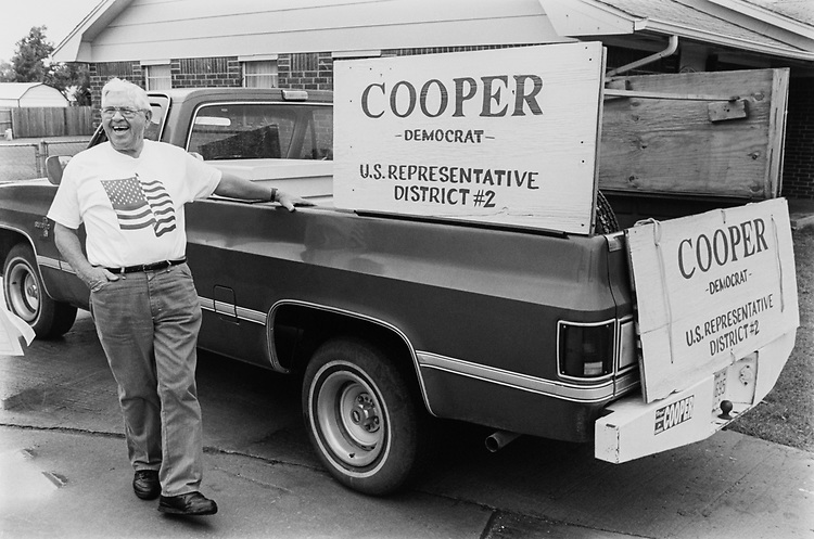 Rep. Nominee Virgil Cooper talking with Tim Burger in the driveway of his Drumright, Oklahoma home in October 1994. (Photo by Chris Martin/CQ Roll Call via Getty Images)
