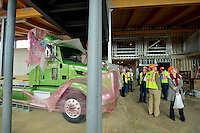 STAFF PHOTO BEN GOFF  @NWABenGoff -- 12/12/14 Members of the Bentonville City Council tour the main gallery area of the Amazeum construction site in Bentonville with members of the Amazeum staff and Nabholz Construction Services on Friday Dec. 12, 2014. The semi truck and shipping container will be incorporated into the Amazeum's 'Lift, Load and Haul' exhibit.