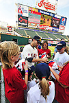 "6 September 2009: Cleveland Indians' utilityman Jamey Carroll signs autographs for kids in the ""Kick-It"" program designed to unite communities in the fight against pediatric cancer. Carroll played kickball with the kids on the field after a game against the Minnesota Twins at Progressive Field in Cleveland, Ohio. The Indians defeated the Twins 3-1 to take the rubber match of their three-game weekend series. Mandatory Credit: Ed Wolfstein Photo"