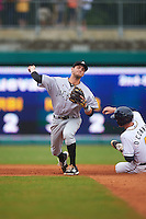 Jackson Generals second baseman Zach Shank (21) turns a double play as Justin O'Conner slides in during a game against the Montgomery Biscuits on April 29, 2015 at Riverwalk Stadium in Montgomery, Alabama.  Jackson defeated Montgomery 4-3.  (Mike Janes/Four Seam Images)
