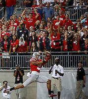 Fans react as Ohio State Buckeyes wide receiver Devin Smith (9) hauls in a touchdown pass in the fourth quarter of the college football game between the Ohio State Buckeyes and the Cincinnati Bearcats at Ohio Stadium in Columbus, Saturday afternoon, September 27, 2014. The Ohio State Buckeyes defeated the Cincinnati Bearcats 50 - 28. (The Columbus Dispatch / Eamon Queeney)