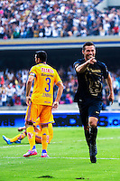 Pumas player Dante Lopez (R ) celebrates his goal against Tigres during their match between Pumas VS Tigres both teams were tied at two goals. Photo by Miguel Angel Pantaleon/VIEWpress
