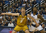 California Baptist center Glenn Morison (12) and Nevada guard Corey Henson (2) go for a rebound in the second half of an NCAA college basketball game in Reno, Nev., Monday, Nov. 19, 2018. (AP Photo/Tom R. Smedes)