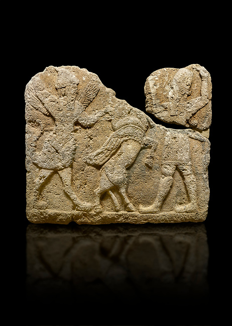 Photo of Hittite relief sculpted orthostat stone panel of Herald's Wall. Limestone, Karkamıs, (Kargamıs), Carchemish (Karkemish), 900-700 B.C. Anatolian Civilisations Museum, Ankara, Turkey.<br /> <br /> On the left is a winged mixed creature with a human head and body who has a scorpion tail and bird legs; on the right is a human-like god. The figures fight with a winged bull standing on its hind legs. The scorpion-man is known as Girtablull. <br /> <br /> Against a black background.